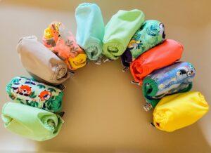 Ein ganzer Regenbogen an Pop-In Newborn Stoffwindeln - unsere Erfahrung zum Einstieg ins wickeln mit Stoffwindeln
